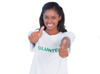 woman wearing volunteer shirt smiling